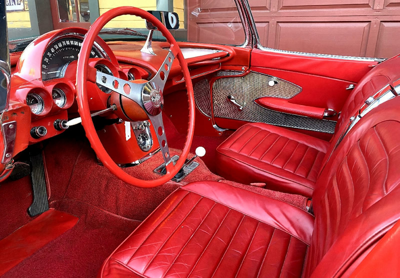 red vinyl interior of a 59 Chevy Corvette