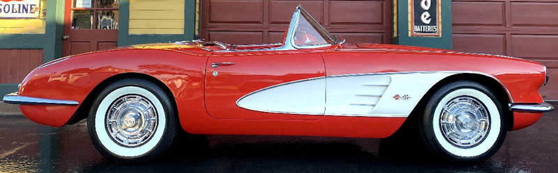 side view of a 1959 Chevrolet Corvette with the top down