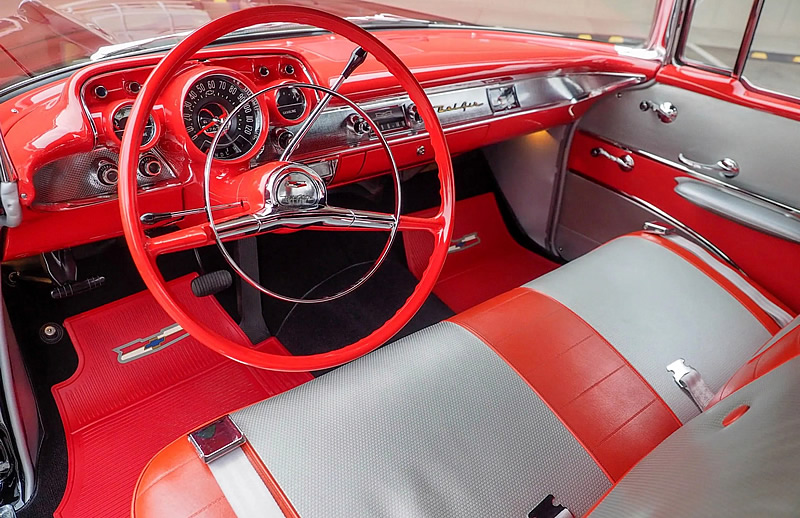 red and silver vinyl interior of a 57 Chevy convertible