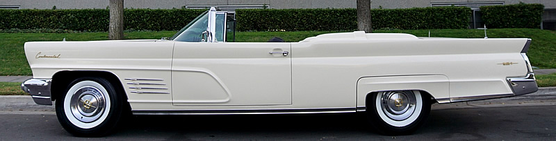 1960 Lincoln Continental Mark V side view with the top down