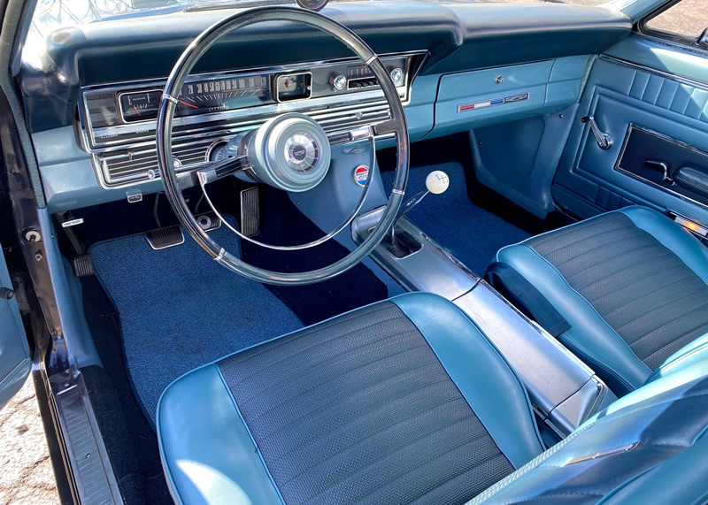 two tone blue interior of a 67 Ford Fairlane GT