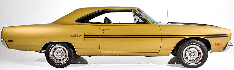 Side view of a 1970 Plymouth GTX in Citron Mist