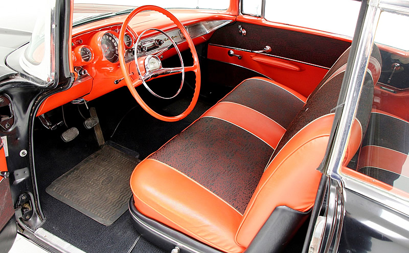red vinyl and black and red pattern cloth interior of a 1957 Chevy Bel Air