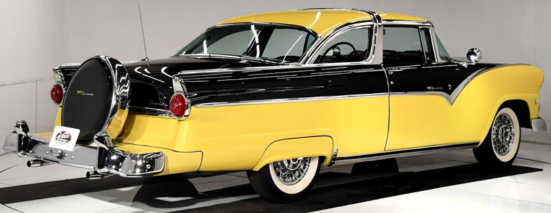 rear view of a 55 Ford Crown Victoria with bumble bee colors