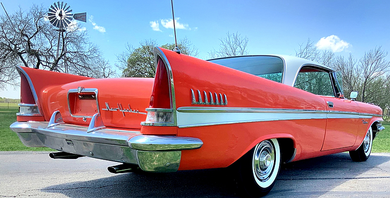 rear view of a 57 Chrysler New Yorker showing its large fins