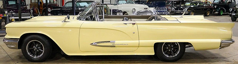 side view of a 59 t-bird convertible with the top down