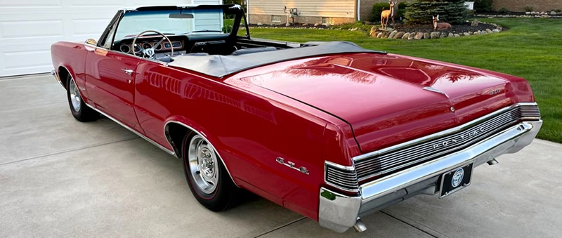 Rear view of a 65 Pontiac GTO convertible with the top down