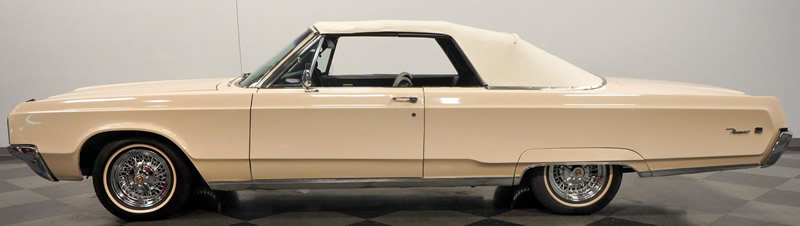 side view of a 68 Chrysler Newport convertible with the top up