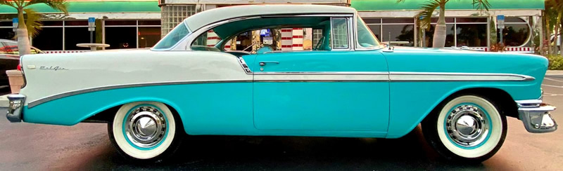 Side view of a 56 Chevy Bel Air in India Ivory over Tropical Turquoise paint
