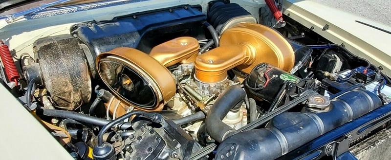 318 cubic inch V8 engine with dual 4-barrel carburetors on a 57 Plymouth Fury