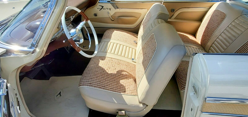 Immaculate cocoa and beige vinyl interior of a 57 Plymouth Fury