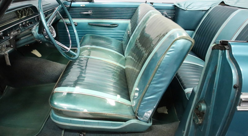 original interior with covered front seat for protection - 1962 Sunliner