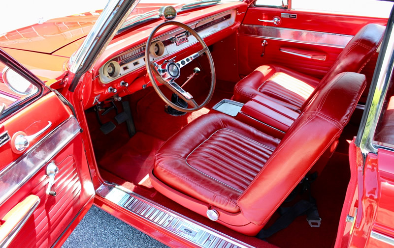 red bucket seat interior in a 64 Falcon Sprint Convertible