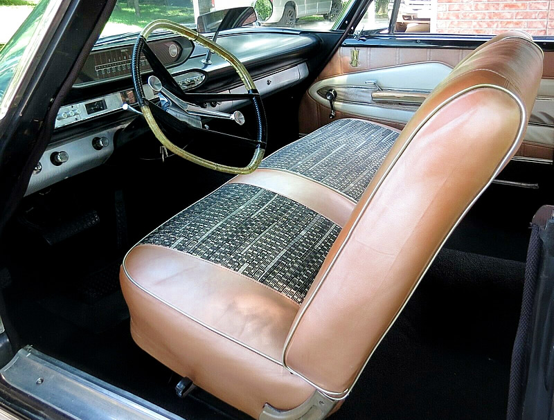 rich fabric and vinyl interior of a '60 Plymouth Fury
