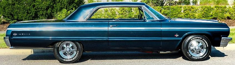 Side view of a 1964 Chevrolet Impala SS in Midnight Blue