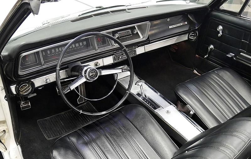 Bucket seat all-vinyl interior of a 1966 Chevy Impala SS convertible