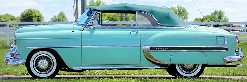 side view of a 53 Chevy Bel Air convertible with the top up