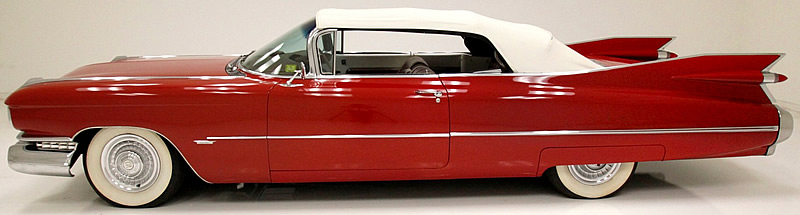 side view of a 1959 Cadillac with the top up.