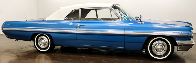 side view of a 1962 Bonneville convertible with the top up